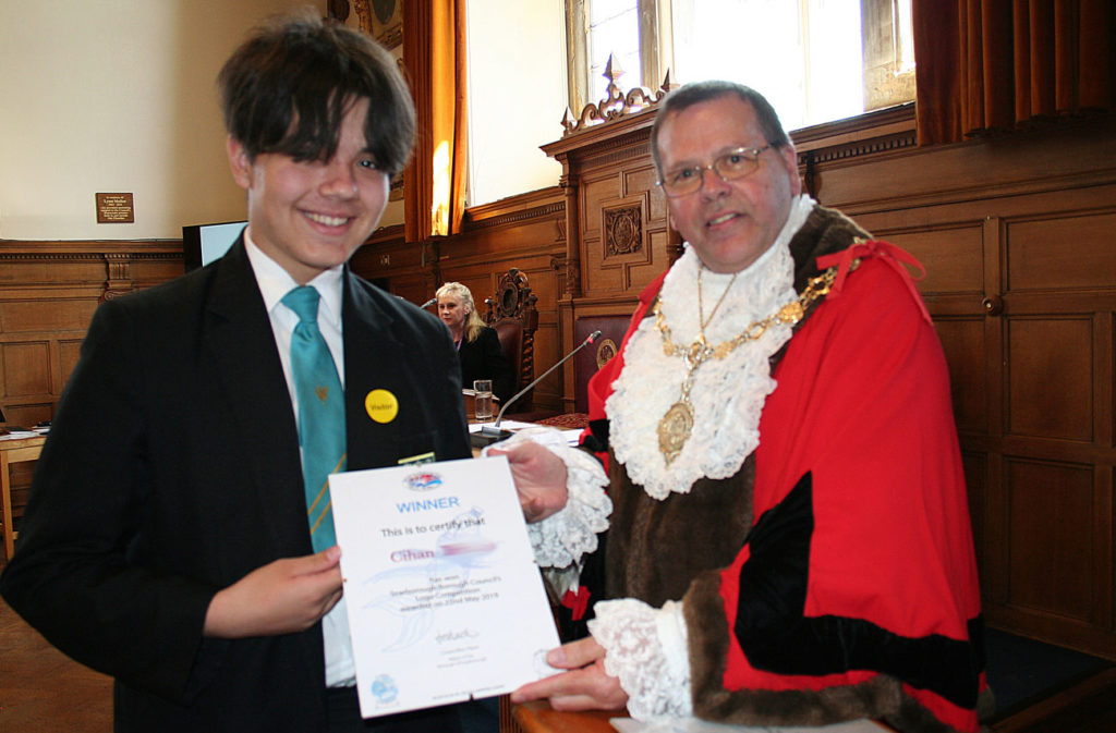 Cihan receiving his logo competition certificate
