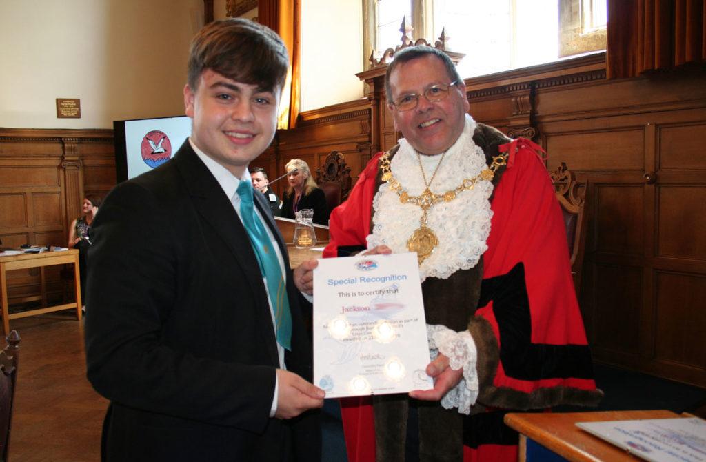 Jackson receiving his outstanding design award