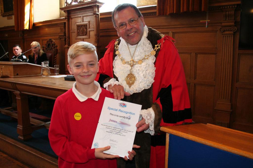 James receiving his outstanding design award