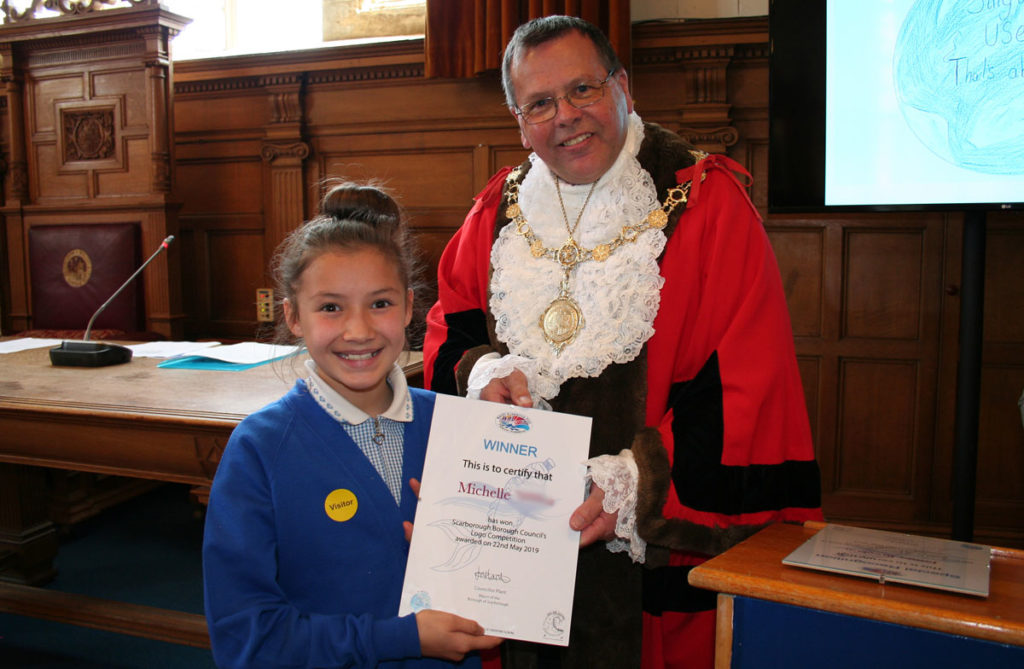 Michelle receiving her logo competition certificate