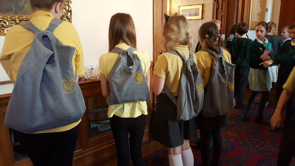 Backpacks made from old school jumpers